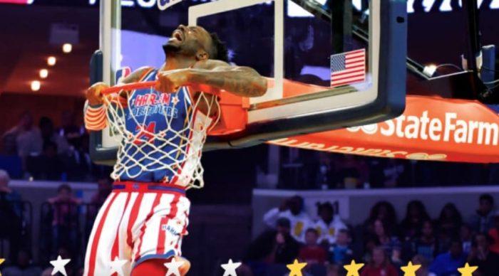 One of the Harlem Globetrotters inside a basketball hoop