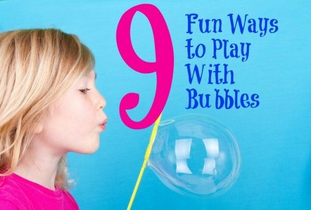 Child or girl blowing bubbles on a blue background