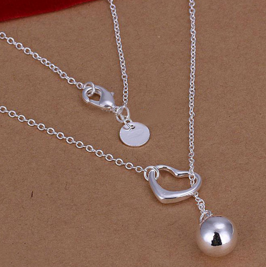 Shot Through the Heart - Silver Heart Hanging Ball Necklace Only $3.98! Ships FREE!!
